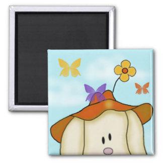 Lapin de bande dessinée avec des papillons magnet carré