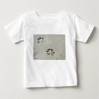 Large dog's paw prints on wet sand baby T-Shirt