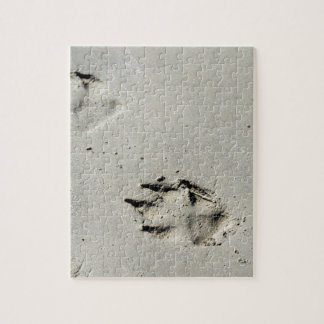 Large dog's paw prints on wet sand jigsaw puzzle