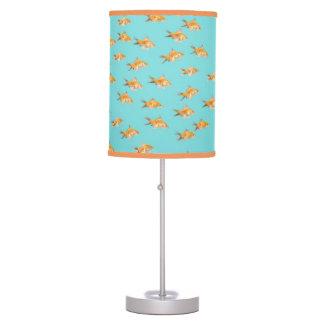 Large group of goldfish facing one lone goldfish table lamp