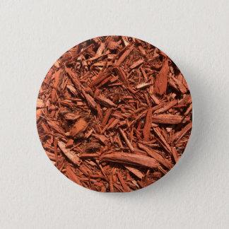 Large red cedar mulch pattern landscape contractor 2 inch round button