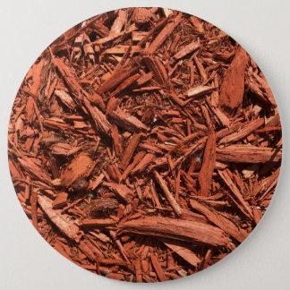 Large red cedar mulch pattern landscape contractor 6 inch round button