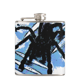Large spider on metal surface hip flask