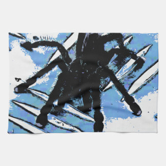Large spider on metal surface kitchen towel