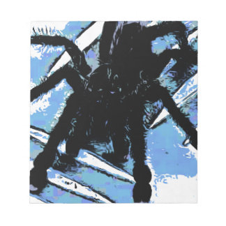 Large spider on metal surface notepad