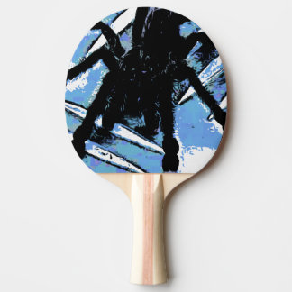 Large spider on metal surface Ping-Pong paddle