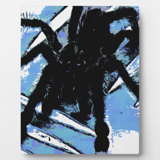 Large spider on metal surface plaque
