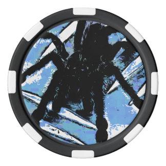 Large spider on metal surface poker chips