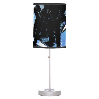 Large spider on metal surface table lamp