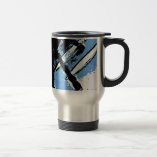 Large spider on metal surface travel mug