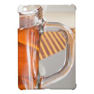 Large transparent glass mug with tea close up iPad mini case