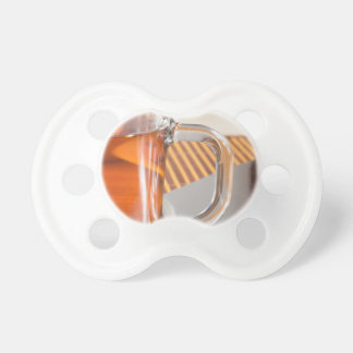 Large transparent glass mug with tea close up pacifier