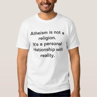L'athéisme n'est pas une religion. C'est un relat Tshirts