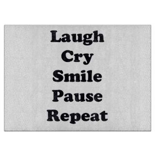 Laugh Repeat Cutting Board