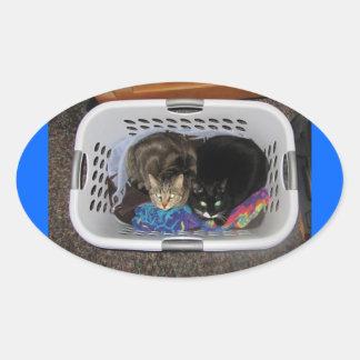 Laundry Basket Kitties Oval Sticker