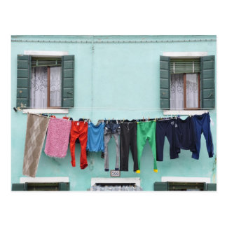 Laundry drying by clothesline, postcard