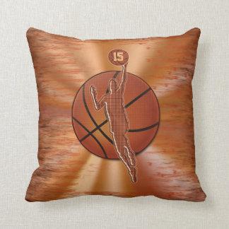 Le basket-ball personnalisé repose le NOM et le Coussin