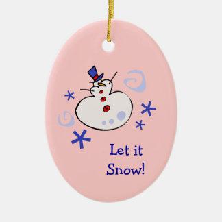 Le bonhomme de neige badine des vacances ornement ovale en céramique