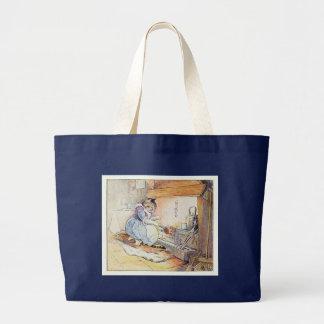 Le chat de chat se repose par le feu sac en toile