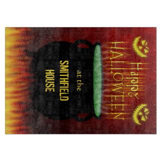 Le feu heureux de chaudron de Halloween Planche À Trancher