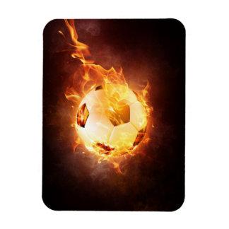Le football, le football, boule sous le feu magnet en vinyle
