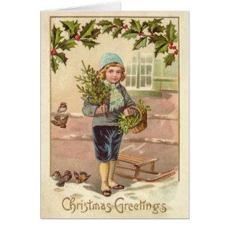Le garçon victorien vintage de carte de Noël, le