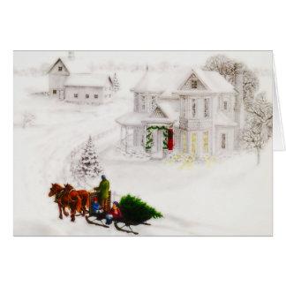 Le papa vintage et les enfants apportent à la mais carte de vœux