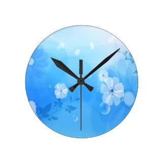 Le résumé fleurit le jardin bleu horloges murales