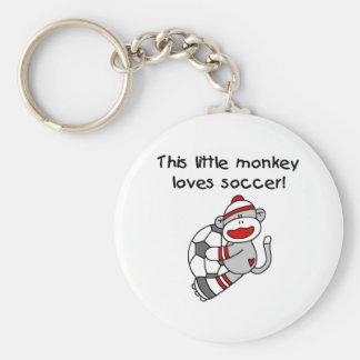 Le singe de chaussette aime le football porte-clé