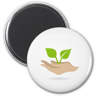Leaf in hands 2 inch round magnet