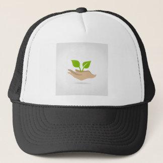 Leaf in hands trucker hat