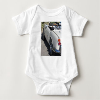Left side of an old british classic car baby bodysuit