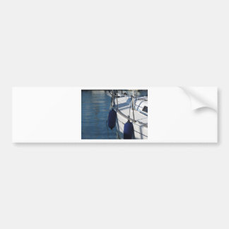 Left side of sailing boat with two blue fenders bumper sticker