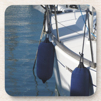 Left side of sailing boat with two blue fenders coaster
