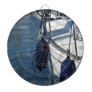 Left side of sailing boat with two blue fenders dartboard