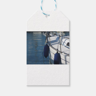 Left side of sailing boat with two blue fenders gift tags