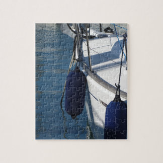 Left side of sailing boat with two blue fenders jigsaw puzzle