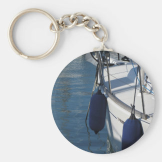 Left side of sailing boat with two blue fenders keychain