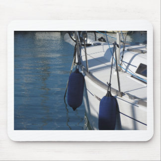 Left side of sailing boat with two blue fenders mouse pad