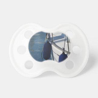 Left side of sailing boat with two blue fenders pacifier