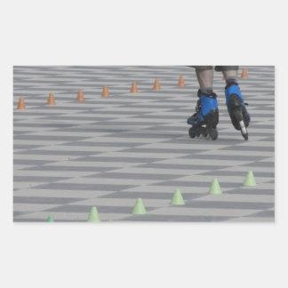 Legs of guy on inline skates . Inline skaters