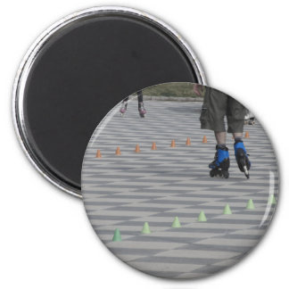 Legs of guy on inline skates . Inline skaters 2 Inch Round Magnet
