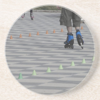 Legs of guy on inline skates . Inline skaters Beverage Coaster