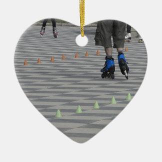 Legs of guy on inline skates . Inline skaters Ceramic Heart Ornament