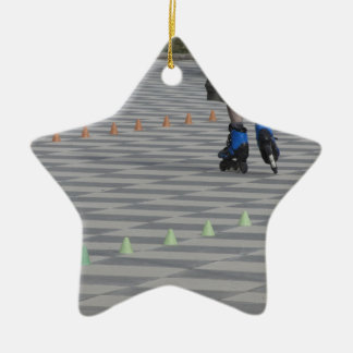Legs of guy on inline skates . Inline skaters Ceramic Star Ornament