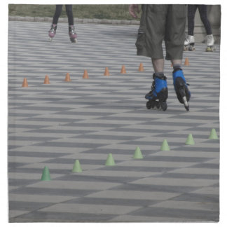 Legs of guy on inline skates . Inline skaters Cloth Napkin