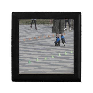 Legs of guy on inline skates . Inline skaters Gift Box