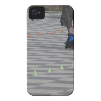 Legs of guy on inline skates . Inline skaters iPhone 4 Case-Mate Case