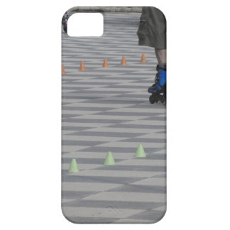 Legs of guy on inline skates . Inline skaters iPhone 5 Cover