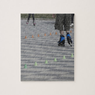 Legs of guy on inline skates . Inline skaters Jigsaw Puzzle
